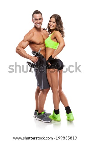 beautiful fitness young sporty couple with dumbbell isolated over white background - stock photo