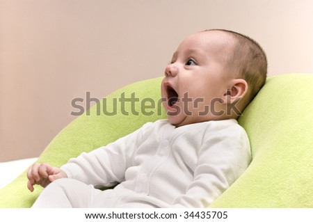 Beautiful five month baby boy laughing - stock photo