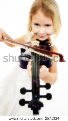 Beautiful five year old girl in white playing purple violin.