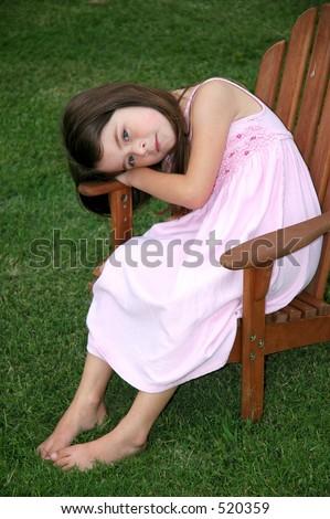 Little Girl Sitting Alone Chair Backyard Stock Photo