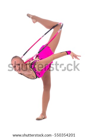 Beautiful flexible girl gymnast staying in a dance position with hoop over white background