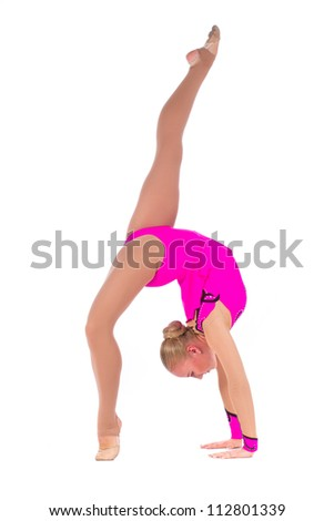 Beautiful flexible girl gymnast staying in a handstand over white background - stock photo