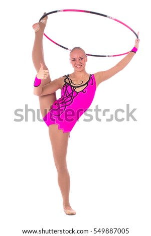 Beautiful flexible girl gymnast staying on one leg up and showing th thump with hoop over white background