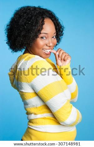 Beautiful flirtatious young black woman - stock photo