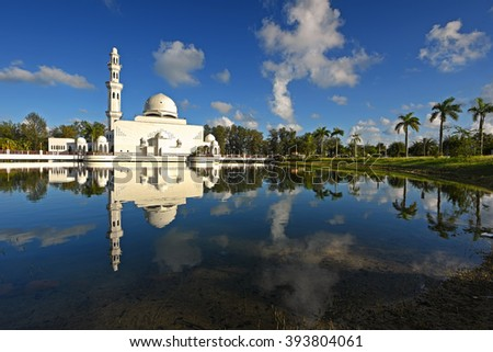 Beautiful floating mosque with reflections of nice blue sky in Terengganu, Malaysia. Nature composition.