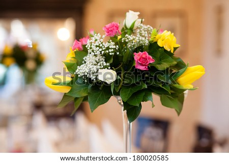 Beautiful floral arrangement in a vase with moody light