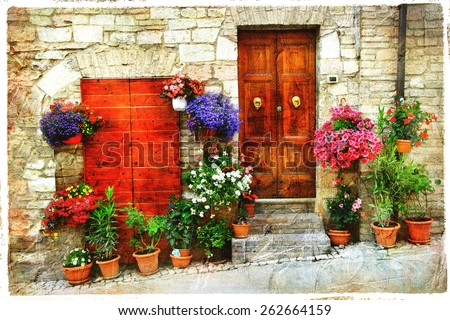 beautiful floral streets of old italian village. Spello, artisti - stock photo