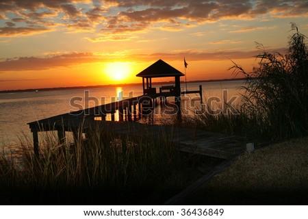 Beautiful Florida Sunset behind Pier - stock photo