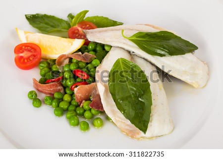 beautiful flow of white fish fillet with beetroot leaves and yellow sauce on a white background isolated for menus peas, tomatoes, basil, bacon, ham, - stock photo