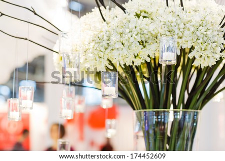Beautiful flower and candle arrangement for wedding or event party - stock photo