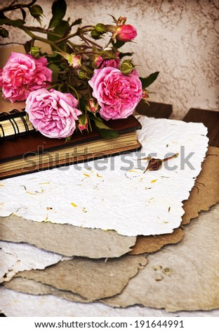 Beautiful flower background with roses and handmade paper, Rose bouquet, wedding card, spring flowers