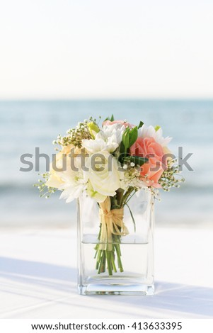 Beautiful flower in the vase wedding on the beach - stock photo