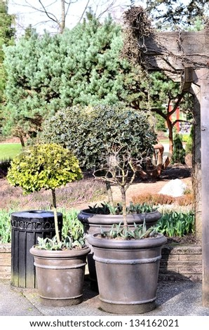 Beautiful flower pot in the park - stock photo