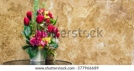 Beautiful flowers in vase with marble background,selective focus - stock photo