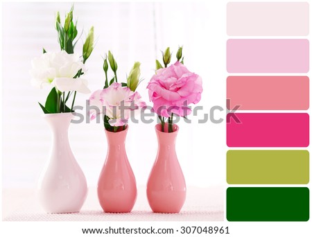 Beautiful flowers in vases and palette of colors - stock photo