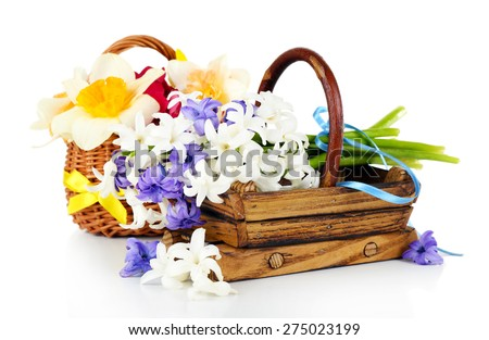 Beautiful flowers in wooden baskets isolated on white