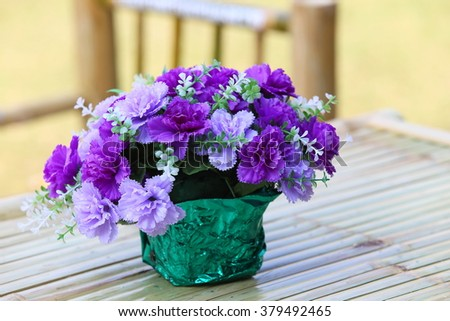 Beautiful flowers on grunge wooden table/ flowers on summer garden background