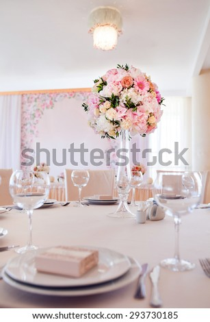 Beautiful flowers on table in wedding day. Wedding table set.