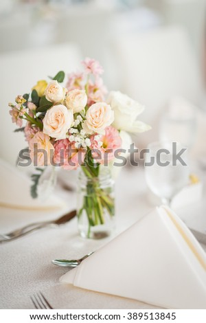 Beautiful flowers used as decoration on table. For wedding and celebratory concepts. - stock photo