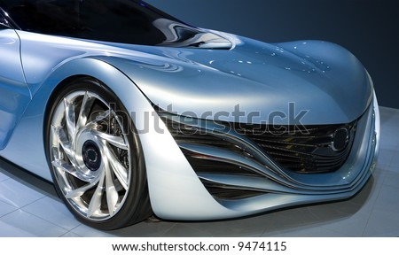 Beautiful flowing lines are emphasized on this new concept car. Given a blue tint for effect. - stock photo