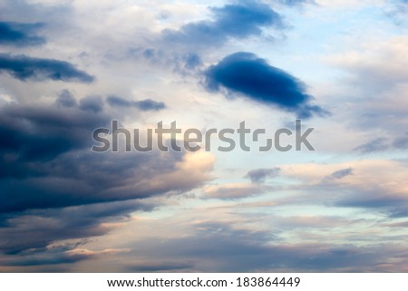 Beautiful, fluffy, white and colored clouds and blue sky