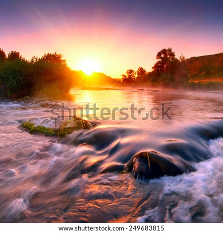 Beautiful fogy morning on the fast river of Ukraine in the light of rising sun - stock photo