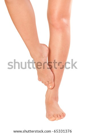 Beautiful foots of young woman isolated on white background. - stock photo
