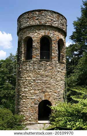Beautiful forgotten bell tower alone in the woods. - stock photo