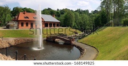 Beautiful fountain in park at the openwork bridge. Belmontas park. Lithuania. - stock photo