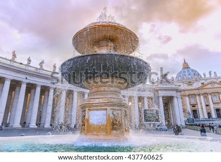Beautiful fountain on the Saint Peter Square (Piazza San Pietro) at sunset against colonnade of the Saint Peter Basilica. Designed by famous sculptor Gian Lorenzo Bernini. Vatican. Rome. Italy.Europe. - stock photo