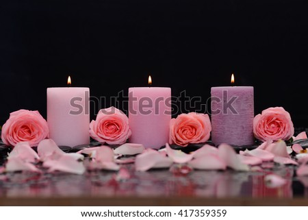 Beautiful four rose with three candle and therapy stones , - stock photo