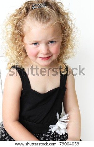 Beautiful four year old girl with blond curls.