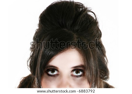 Beautiful fourteen year old girl in goth hair style and make-up. - stock photo
