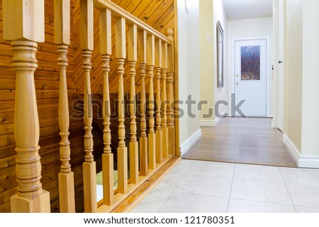 Beautiful foyer and hardwood stairs in new house - stock photo
