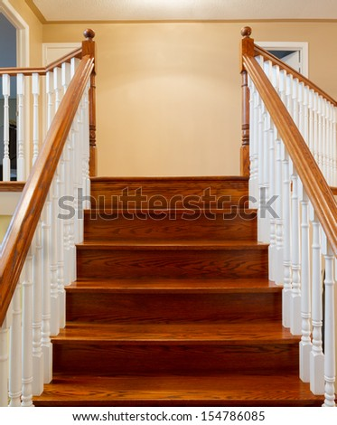 Beautiful foyer looking down hardwood stairs in new house - stock photo