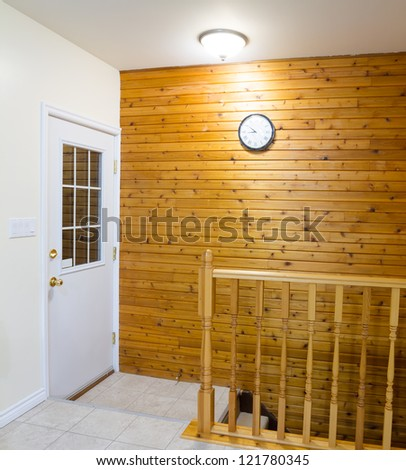 Beautiful foyer with retro door and stairs in new house - stock photo