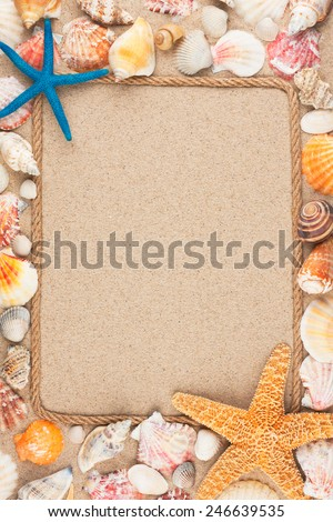 Beautiful frame of rope and seashells on the sand, with place for your image, text