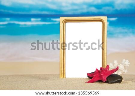 Beautiful frame, starfish, coral and pebble on sand - stock photo
