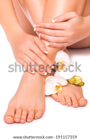 beautiful french manicure and pedicure  with white orchidand