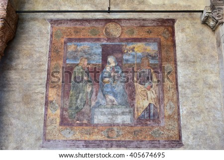 Beautiful fresco with Virgin Mary and Jesus among two saints, painted by the artist Francesco Moroni in the 16th century, just outside San Fermo Maggiore church side portal - stock photo