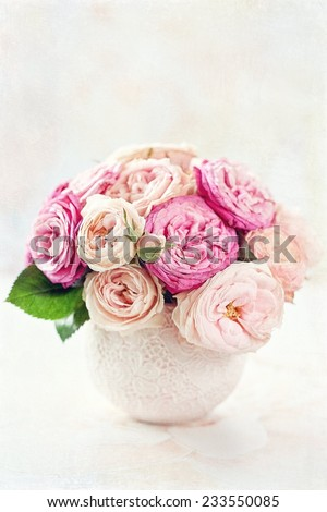 Beautiful fresh pink roses on a light background . - stock photo