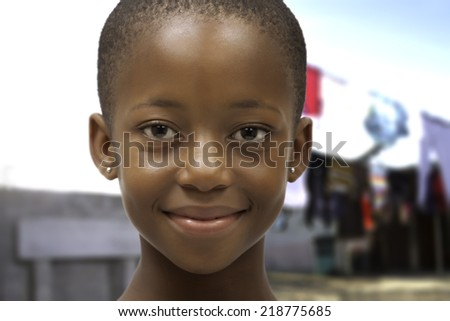 beautiful friendly black south african girl smiling head and shoulders - stock photo