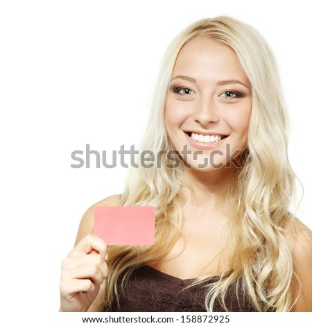 beautiful friendly smiling confident girl showing red card in hand, over white background  - stock photo