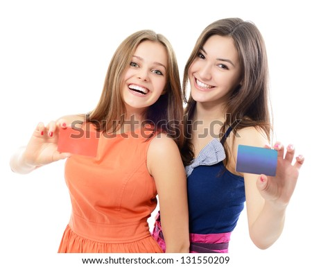 beautiful friendly smiling confident young women showing club cards in hands, over white background