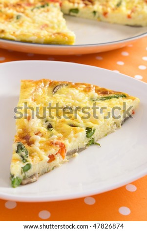 Beautiful frittata filled with asparagus, red bell pepper, mushrooms, ricotta, and parmesan cheese. - stock photo