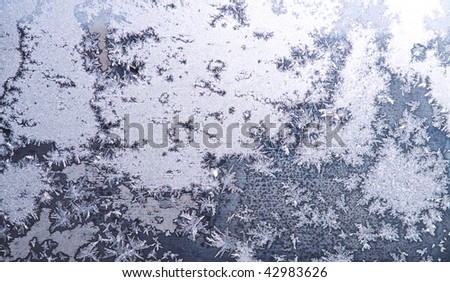 Beautiful frost background on a glass window - stock photo