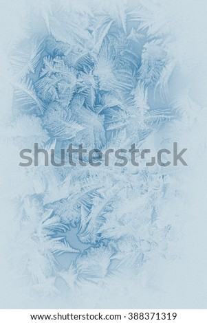 Beautiful frost pattern on a window glass (in subdued colors, retro style) - stock photo