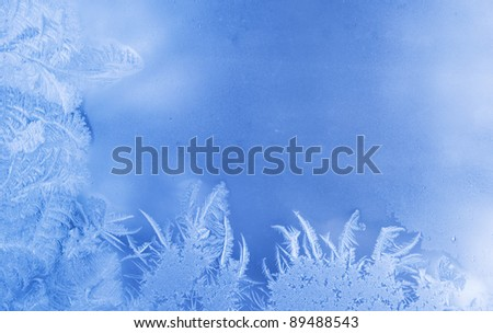 Beautiful frost pattern on a window glass, with empty space for your text or image (as a New Year background) - stock photo