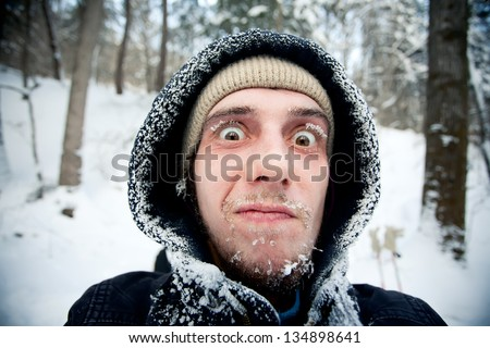beautiful frozen face of brave hiker. Russia, Pidan - stock photo