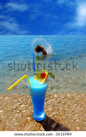 Beautiful fruit cocktail at the sunny beach - stock photo